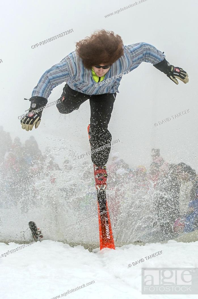Stock Photo: Fun event Moopstock on the end of a successful ski season 2017-2018 and competition at the crossing water pond (lake) on skis and snowboard in Horni Mala Upa.