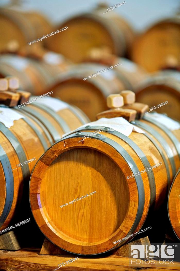 Stock Photo: Balsamic vinegar maturing in wooden barrels.