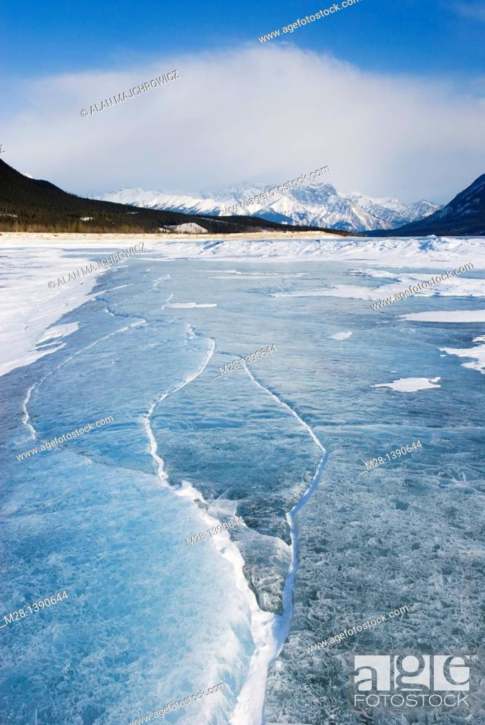 Stock Photo: Abstract patterns in the wind polished ice of Abraham Lake, Alberta Canada.
