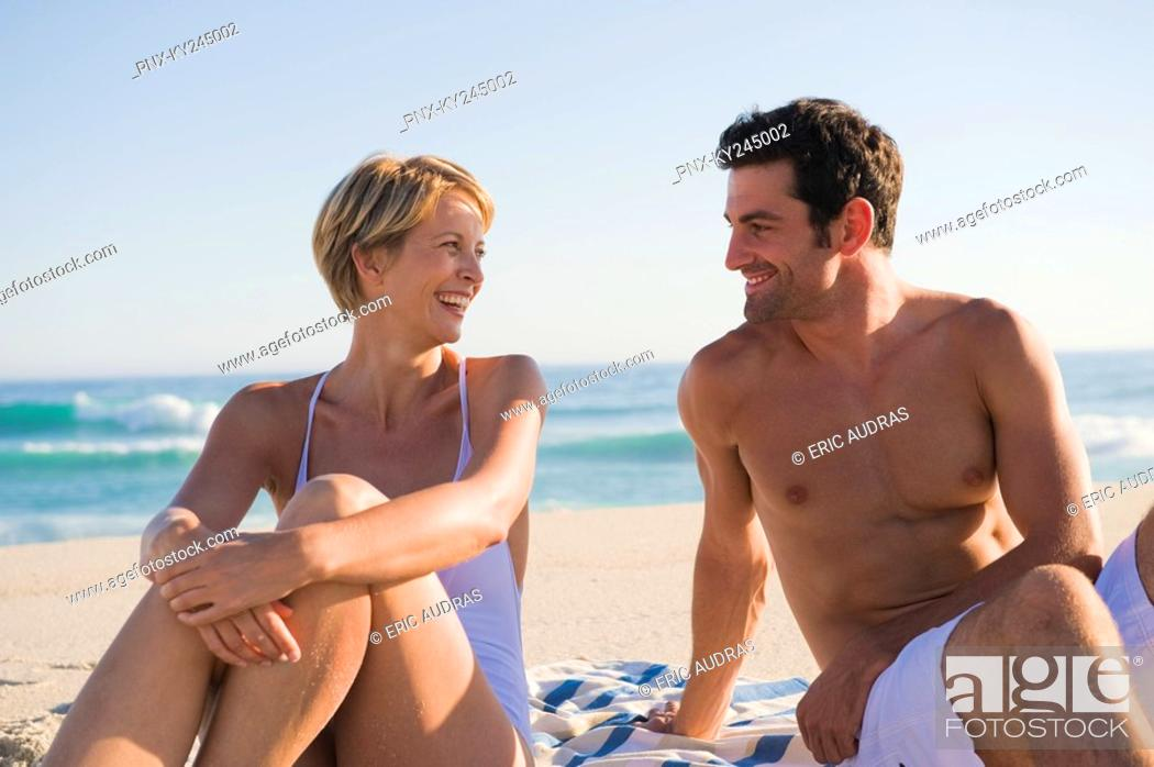 Stock Photo: Couple sitting on the beach.