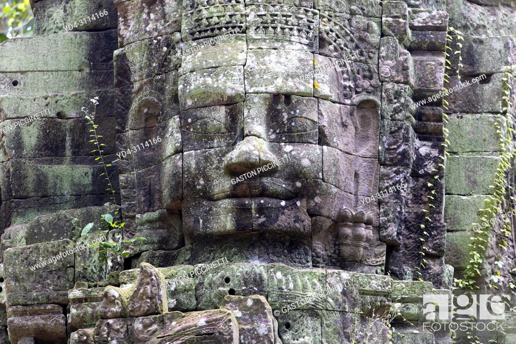 Stock Photo: Stone faces at Ta Som temple, Angkor, Siem reap, Cambodia, built at the end of the 12th century for King Jayavarman VII. It is located north east of Angkor Thom.