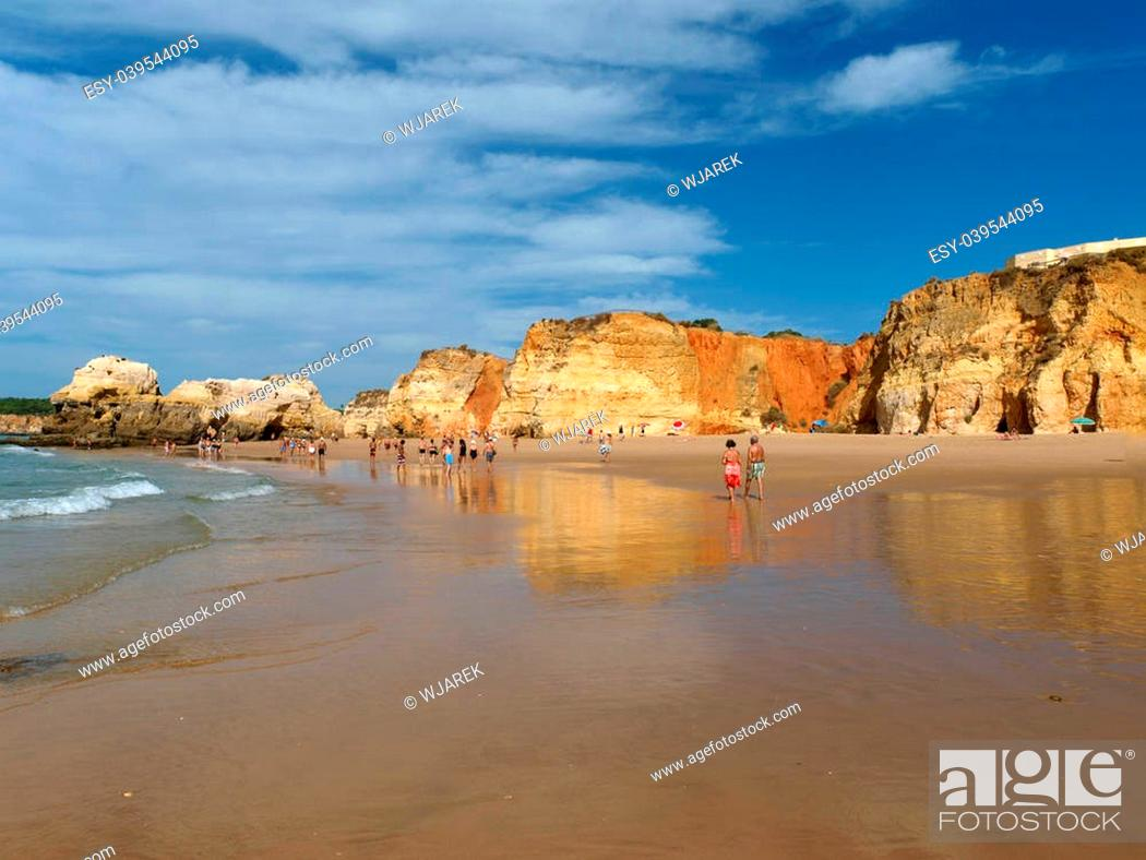Stock Photo: A section of the idyllic Praia de Rocha beach on the Algarve region.