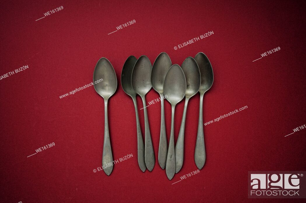 Stock Photo: Red silver spoons.