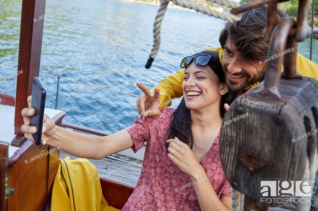 Stock Photo: Couple taking a selfie, Sailboat, Port of Pasaia, Gipuzkoa, Basque Country, Spain, Europe.