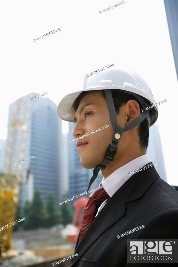 Stock Photo: Businessman with a hard hat.