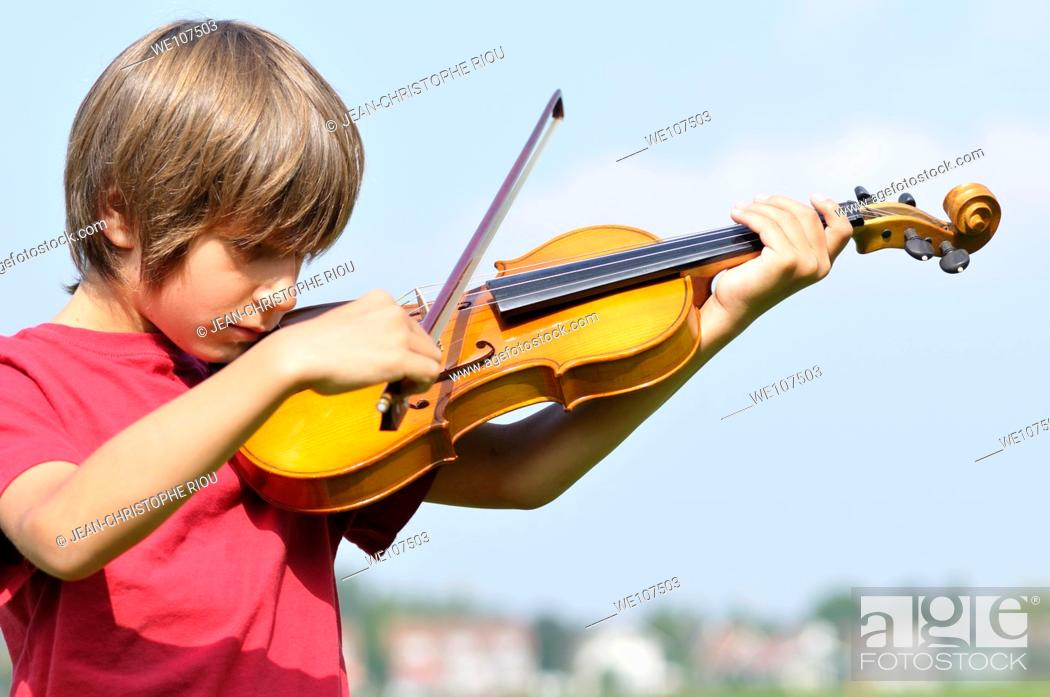 Stock Photo: Boy playing violin.