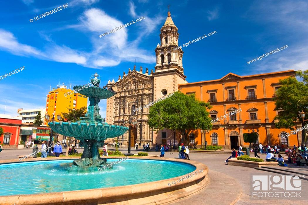 Stock Photo: Fountain at a town square, Plaza Del Carmen, San Luis Potosi, Mexico.