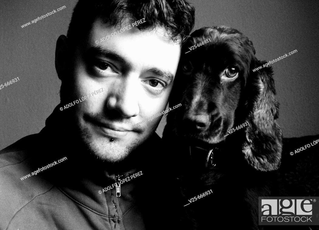 Stock Photo: Young man with dog.