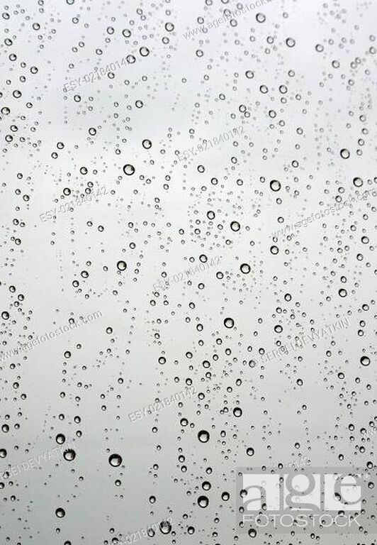 Stock Photo: Drops of rain on the inclined window (glass).