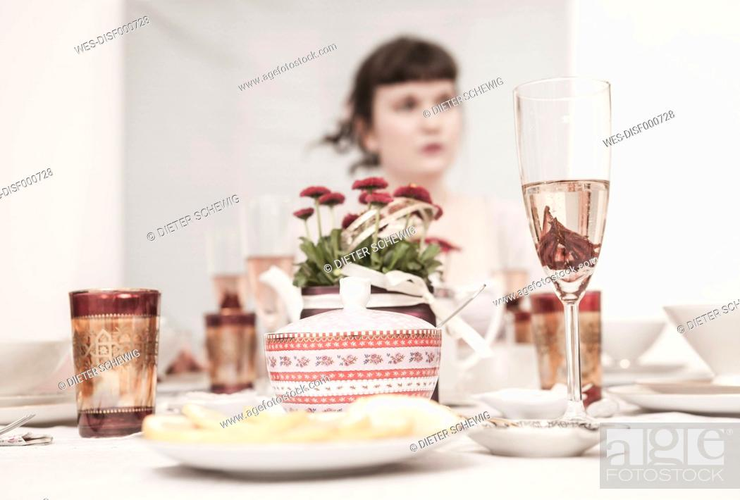 Stock Photo: Young woman on a retro style tea party.