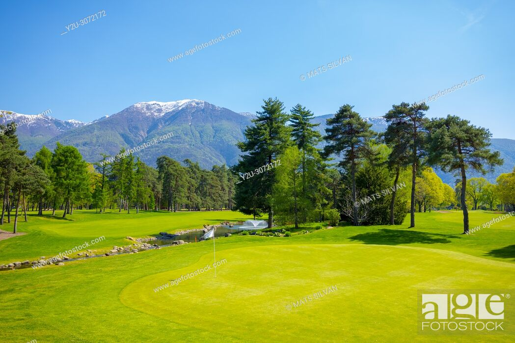 Stock Photo: Hole 8 in Golf Club Ascona with Trees and Mountain in Ticino, Switzerland.