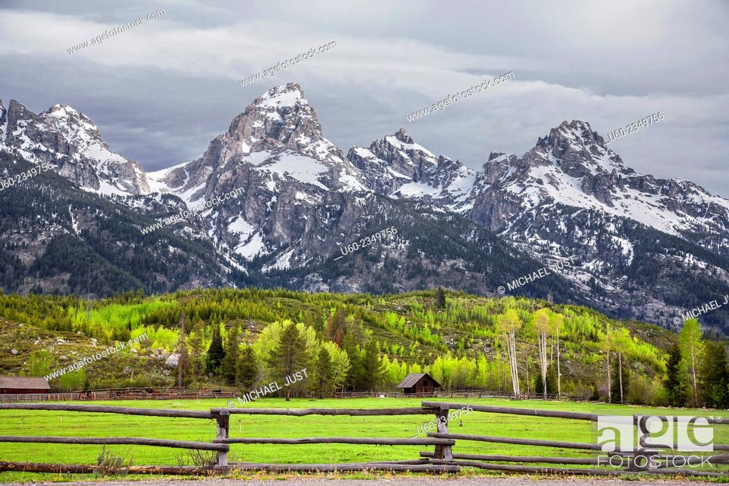 Stock Photo: The snow-covered Grand Tetons rise sharply from the valley floor at Jackson Hole Wyoming and Grand Teton National Park.
