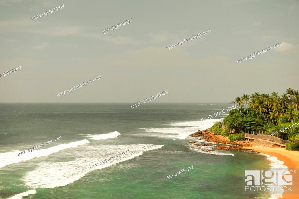 Stock Photo: travel, tourism, vacation, seascape and summer holidays concept - sea or ocean waves and blue sky on Sri Lanka beach.
