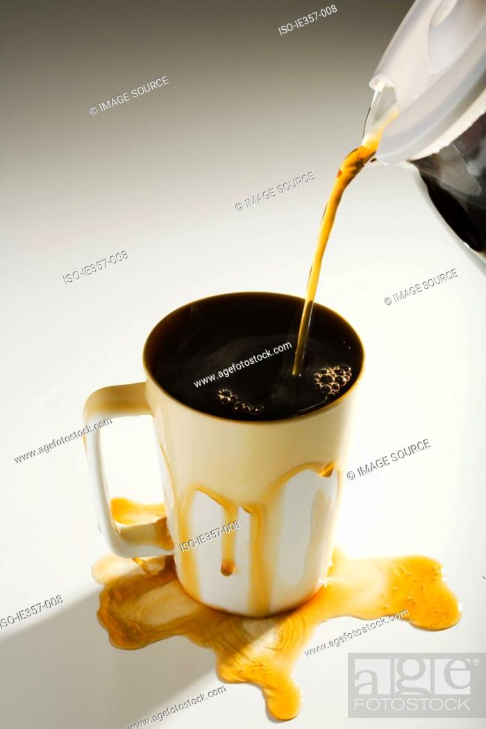 Stock Photo: Coffee spilling out of a cup.