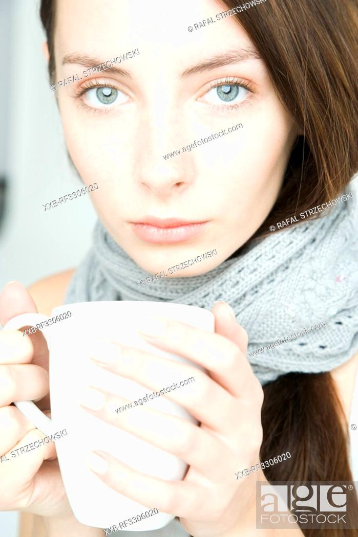 Stock Photo: young woman with white cup.