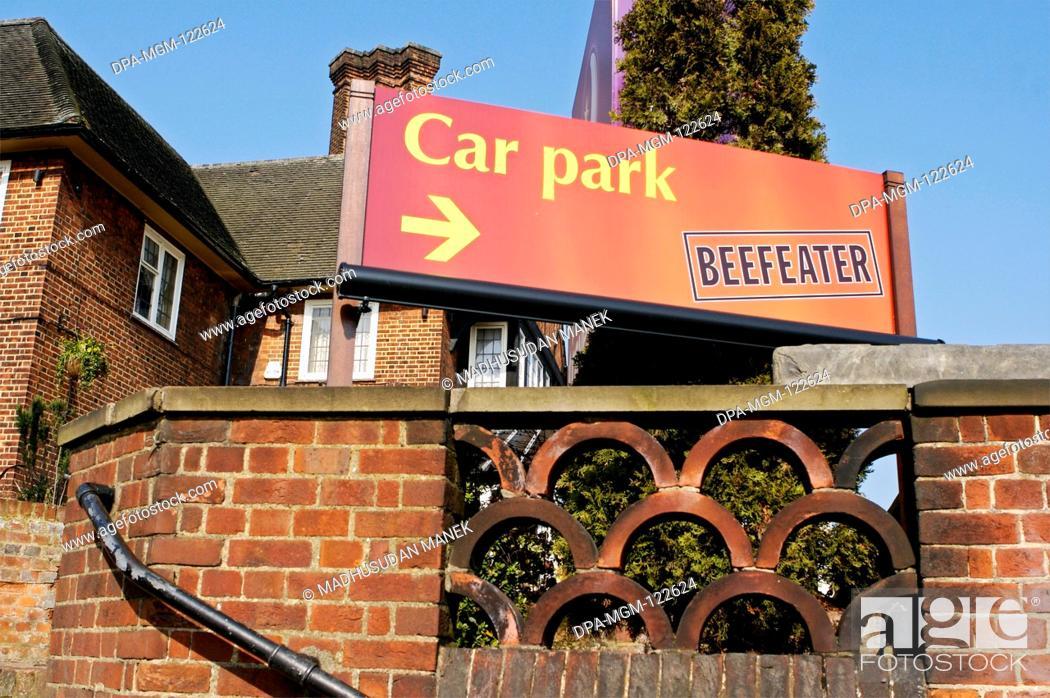 Stock Photo: Car parking directions Beefeater Pub ; London ; U.K. United Kingdom England.
