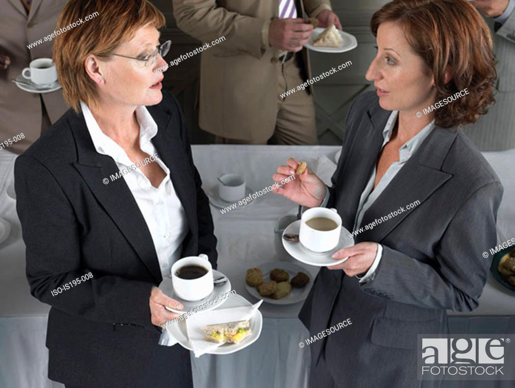 Stock Photo: Office workers having a coffee break.
