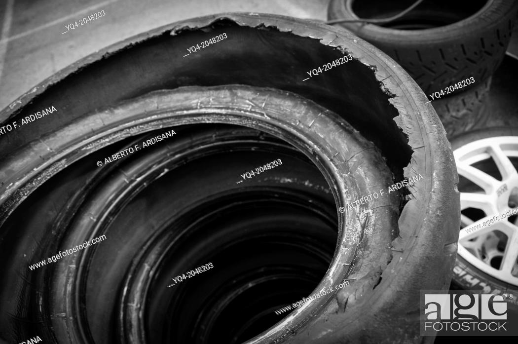 Stock Photo: racing tire broken during the rally. Rally Championship asphalt Spain Villa de Llanes 2013. Asturias. Spain.