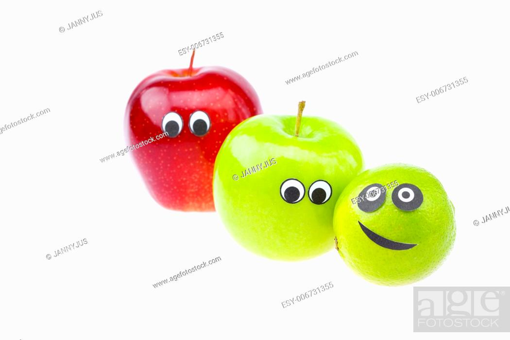 Imagen: apples with faces joy isolated on white.