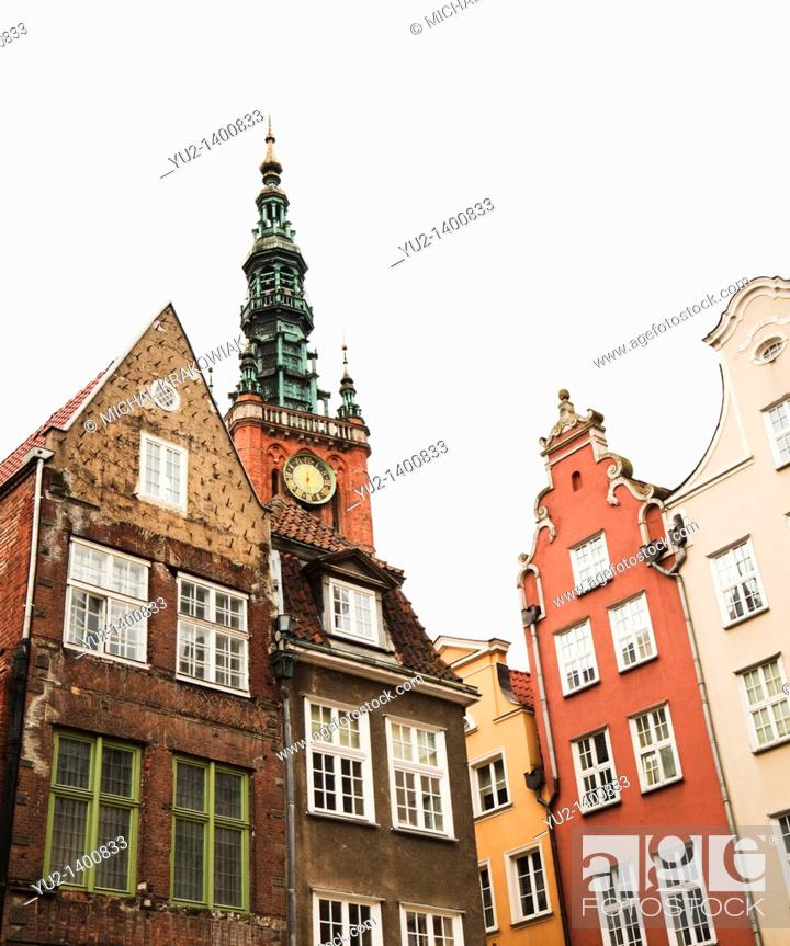 Stock Photo: Townhouses in old town of Gdansk with tower of old town hall in the background.
