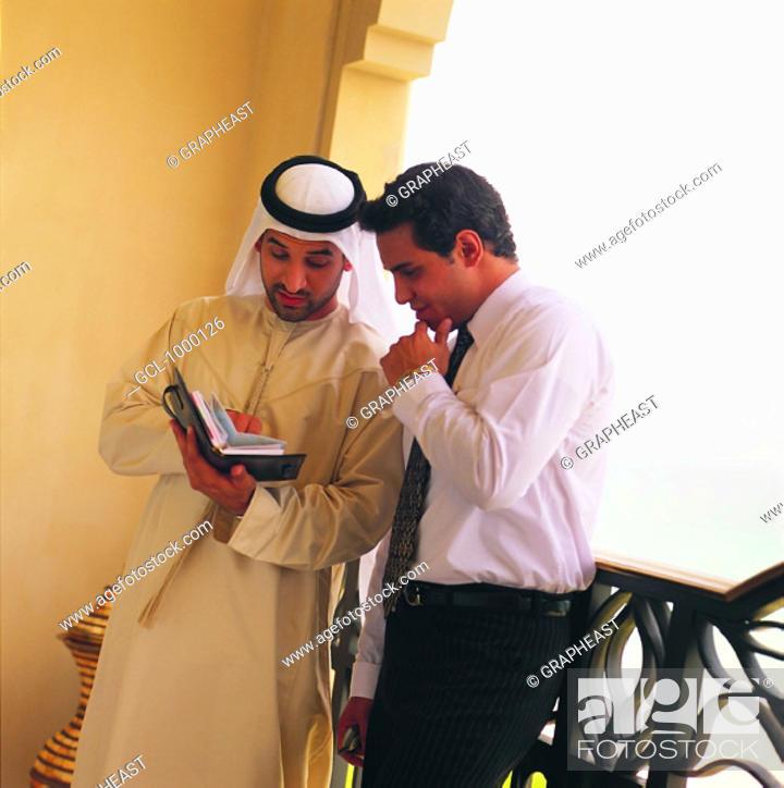 Stock Photo: Arab businessmen discussing agenda.