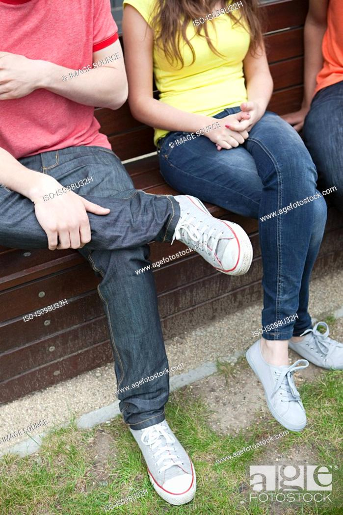 Stock Photo: People sitting on a bench.