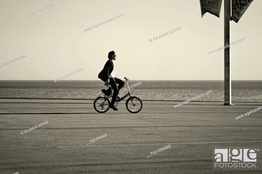 Stock Photo: Riding a bicycle on the Fórum de Barcelona. Catalonia. Spain.