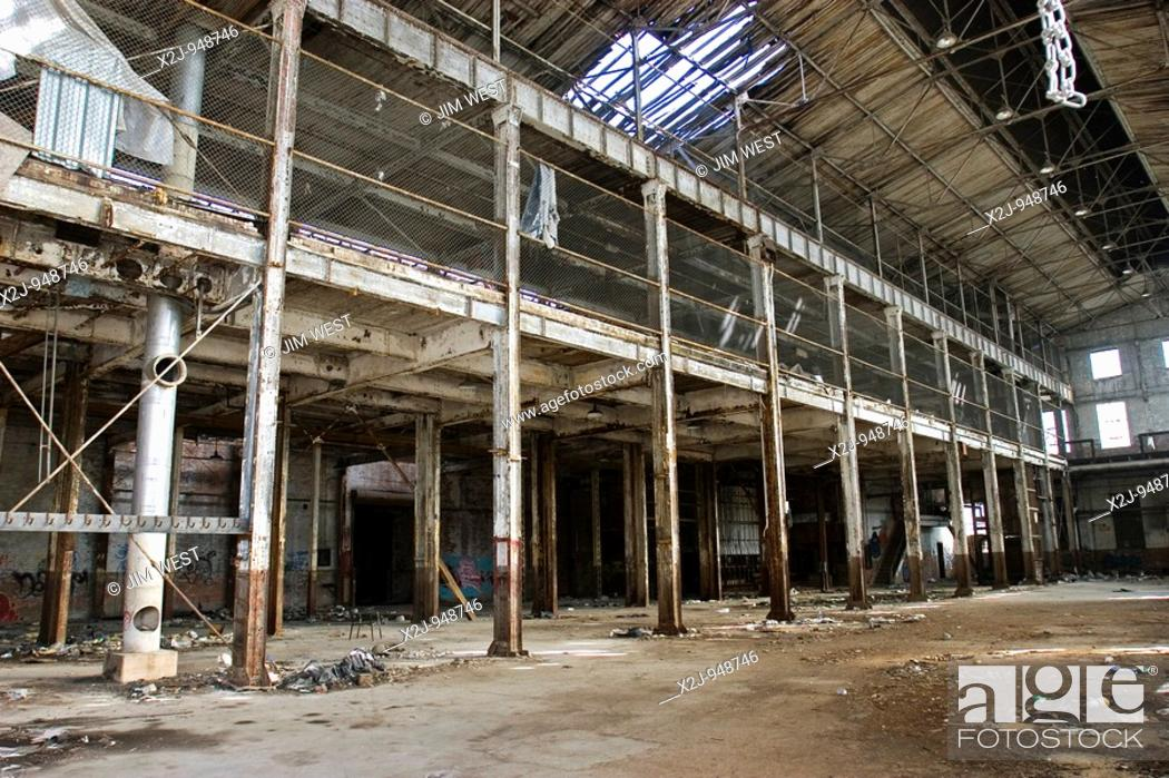 Stock Photo: Detroit, Michigan - A factory sits empty and abandoned near downtown Detroit  Homeless people use it for shelter.