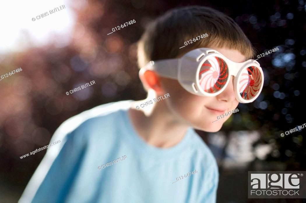 Stock Photo: Boy, age 7, wearing big sunglasses.