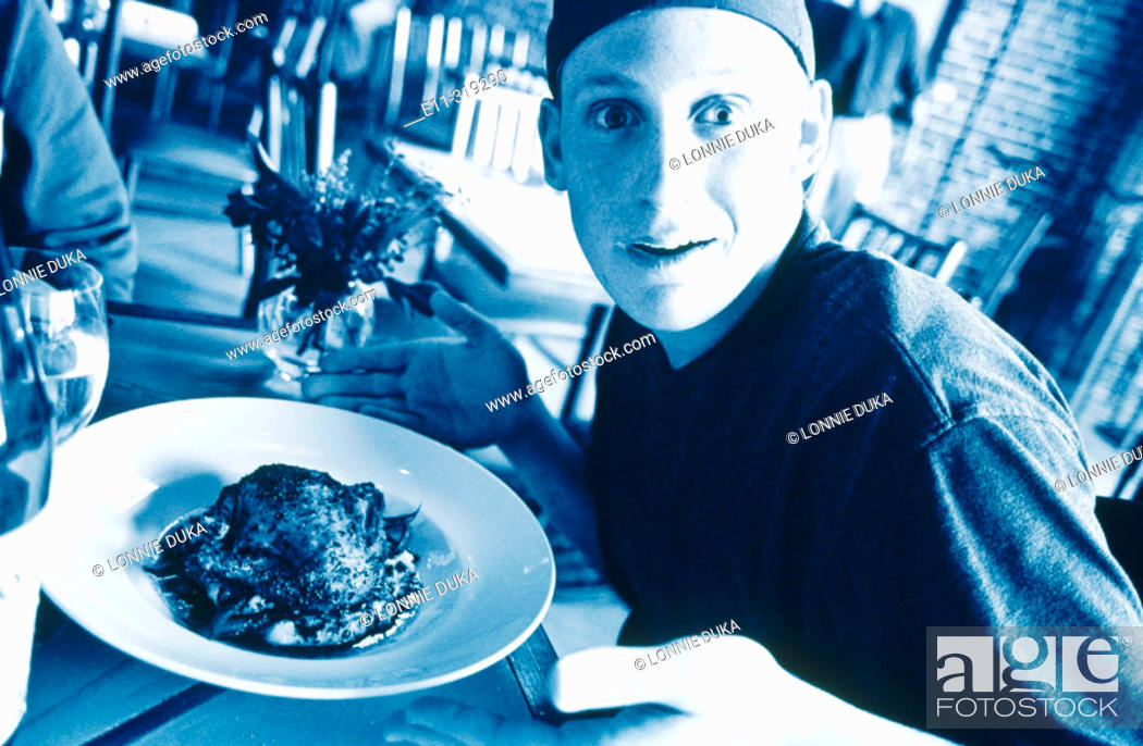 Stock Photo: Teen boy with chicken dish.