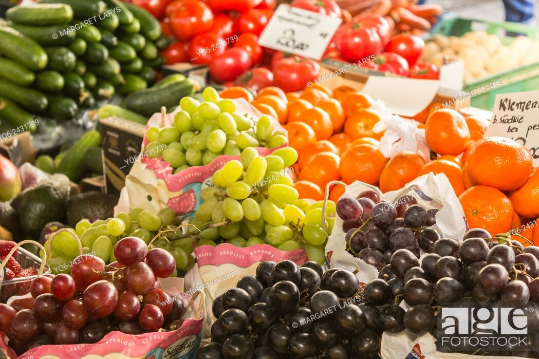 Stock Photo: Selection of fresh, green and black grape and various vegetables at the farmers market in Krakow, Poland.
