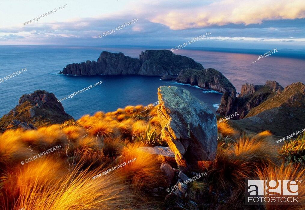 Stock Photo: Sunset Ruggedy Point Rakiura National Park Stewart Island New Zealand.