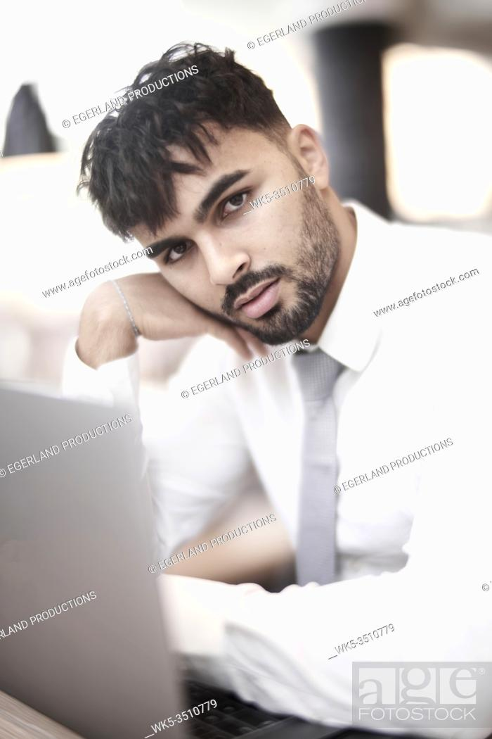 Stock Photo: Businessman in cafe with laptop.