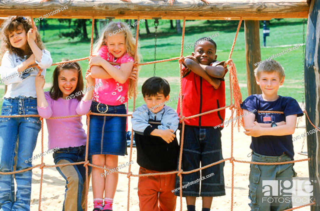Stock Photo: Young children playing on a jungle gym.