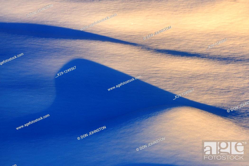 Stock Photo: Late evening shadows on snow.