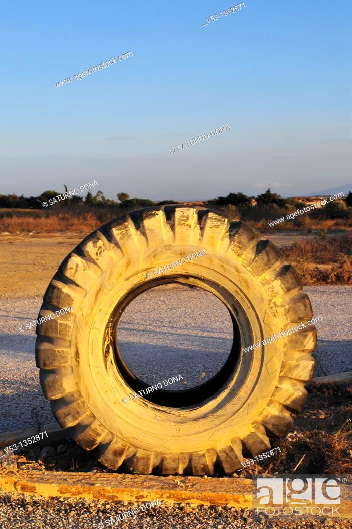 Stock Photo: truck tire at dusk.
