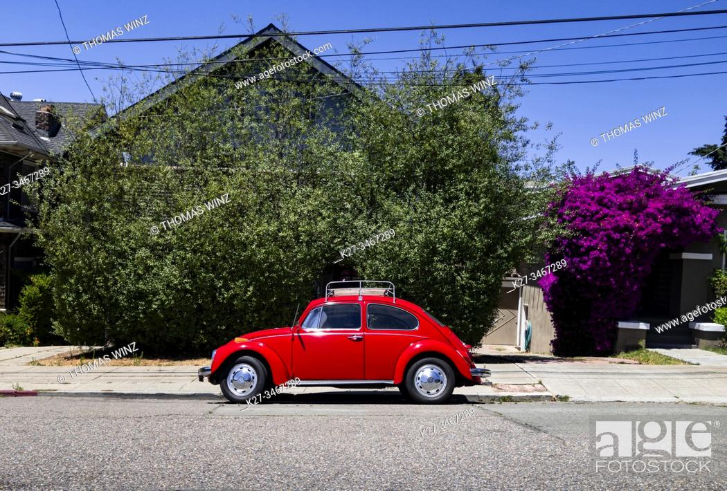 Stock Photo: Historic red Volkswagen Bug parked in a residential neighborhood, California, USA.