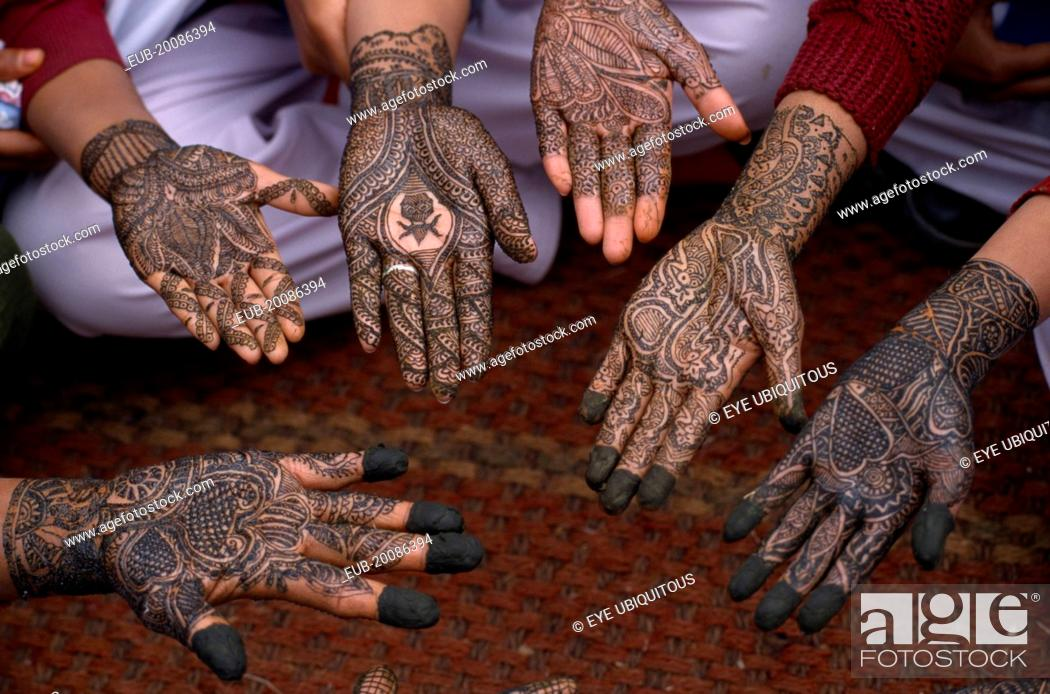 Group Mehndi Hands : Detail of a group hands with various henna designs in the mehndi