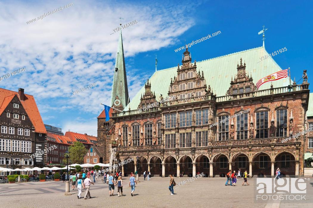 Stock Photo: View over the marketplace of Bremen to the Church of Our Lady and the town hall The Bremen Town Hall is one of the most important monuments of the Gothic and.