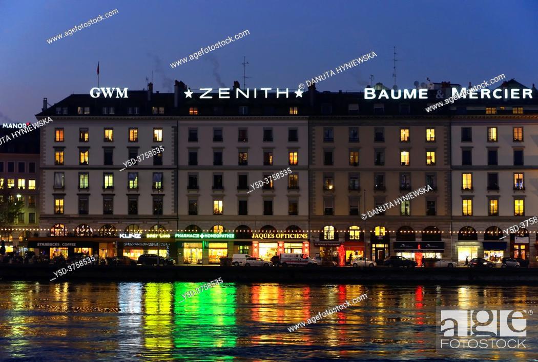 Stock Photo: reflections of buildings along Quai des Bergues in Rhone river, downtown of Geneva at dusk, Switzerland.