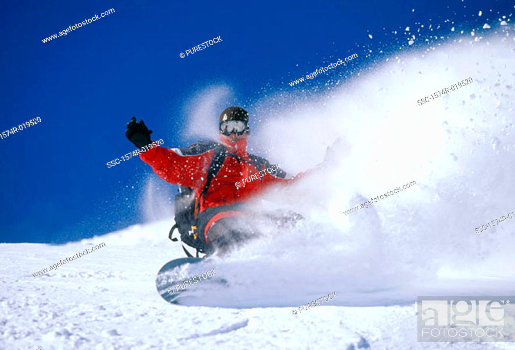 Stock Photo: Person snowboarding downhill, Tignes, France.