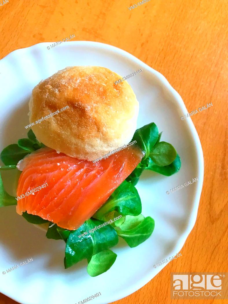Stock Photo: Smoked salmon with watercress on bread. View from above.