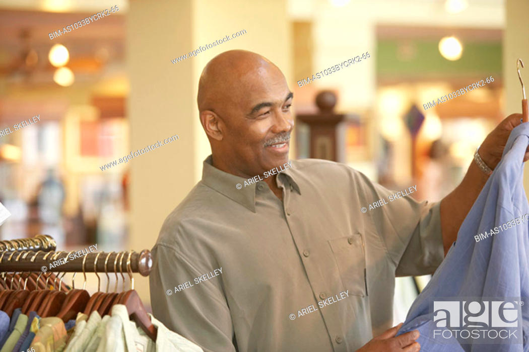 Stock Photo: Man shopping for clothing.