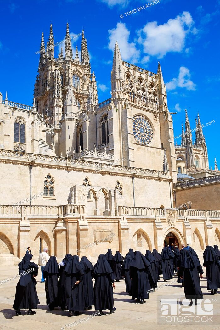 Stock Photo: Burgos Cathedral facade in Saint James Way with unknown nuns at Castilla Leon of Spain.
