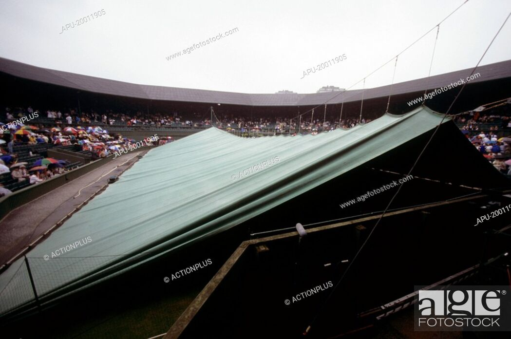 Stock Photo: Covers are pulled over court as rain stops play at a tennis tournament.