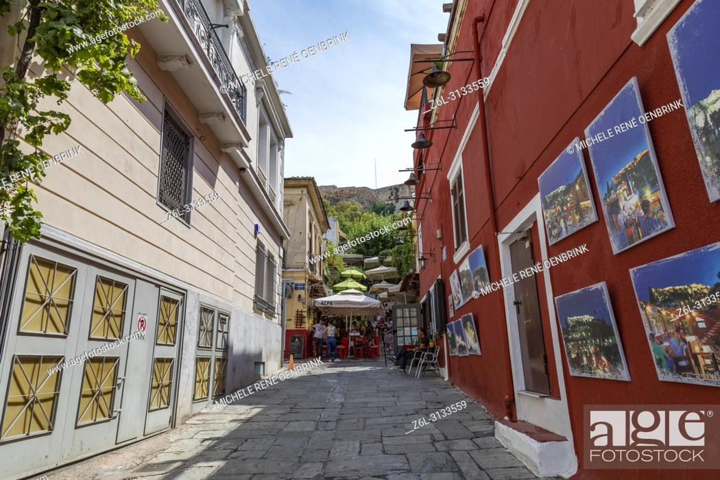 Stock Photo: Cafes and tavernas on Mnisikleous Street in the Plaka district, Athens, Greece.