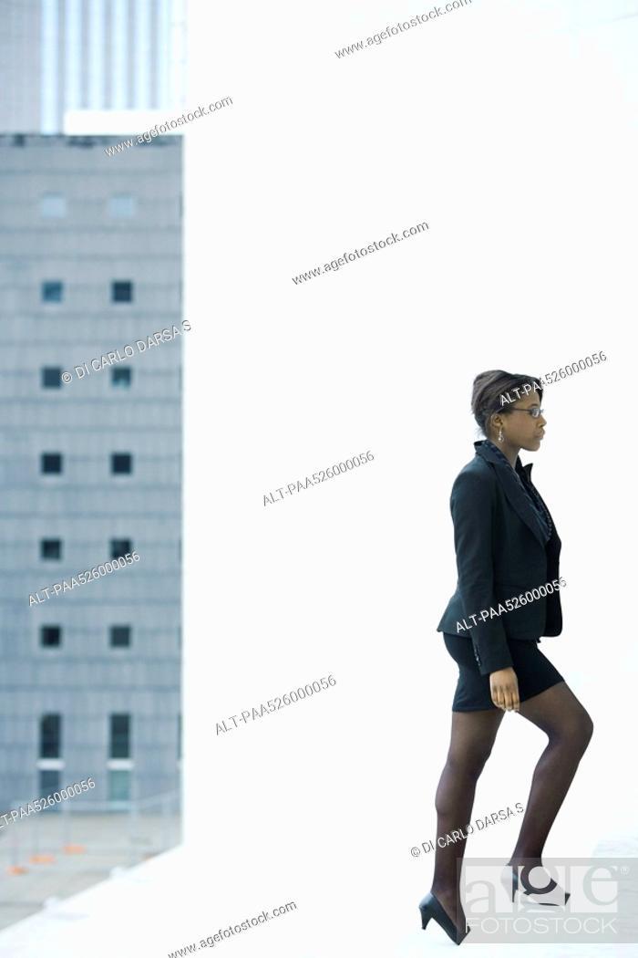 Stock Photo: Businesswoman walking up steps.