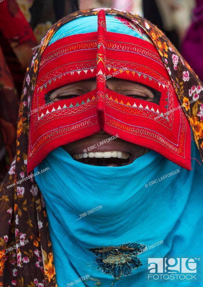 Stock Photo: Iran, Hormozgan, Minab, a laughing bandari woman wearing a traditional mask called the burqa at panjshambe bazar thursday market.