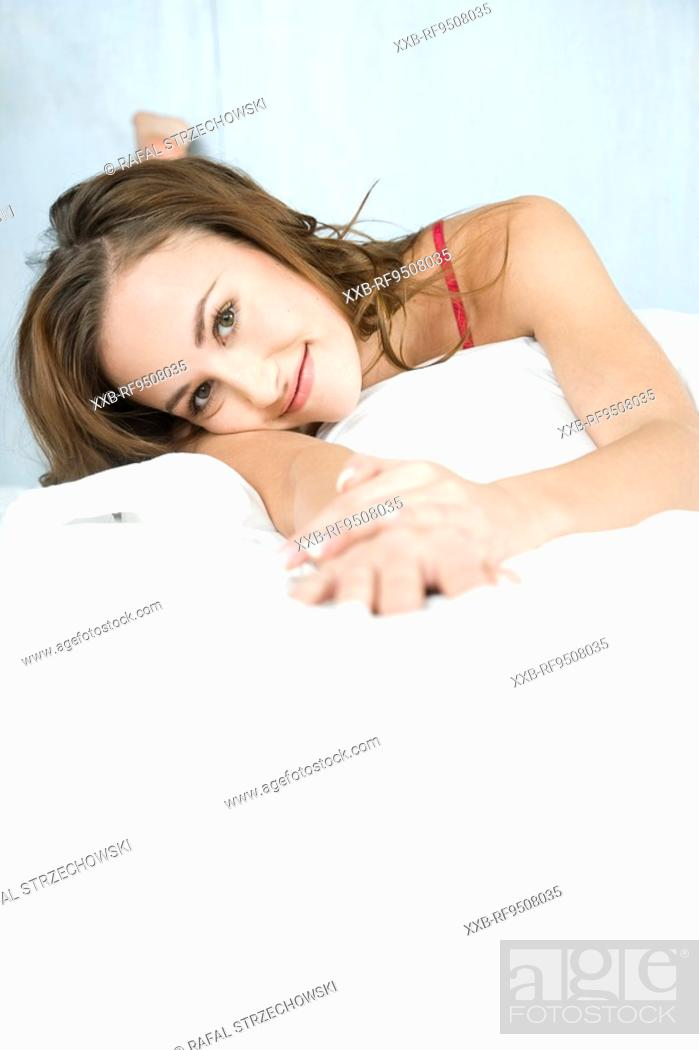 Stock Photo: woman lying in bed.