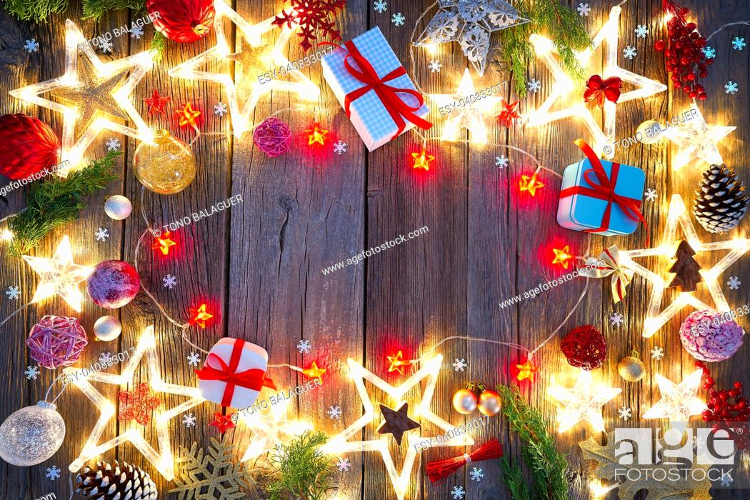 Stock Photo: Christmas background postcard vintage stars on wood background.